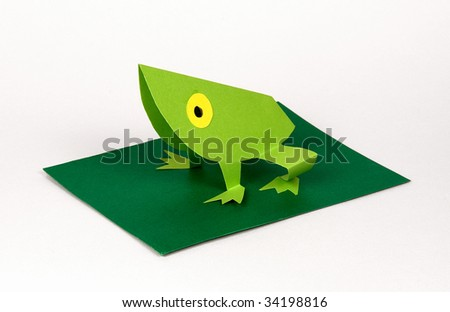 a frog made with paper,origami - stock photo