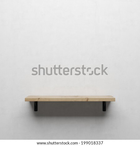 A front view of a regular cleared wooden shelf with brackets on a white wall  - stock photo