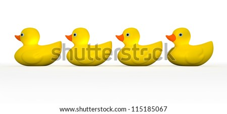A front view of a row of four organized and ready yellow rubber ducks - stock photo
