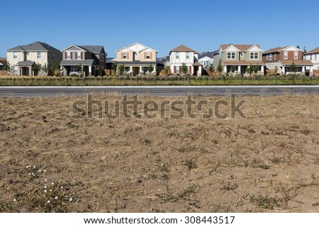A front view of a row of new houses. - stock photo