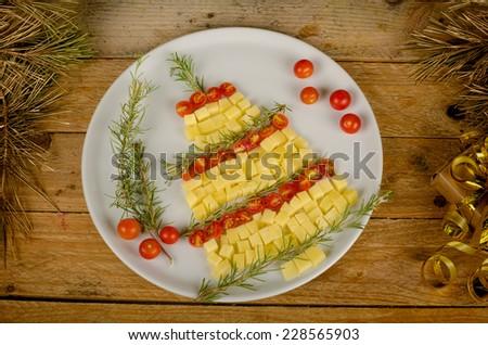 A fruit salad set up as a Christmas tree, creative kid food - stock photo