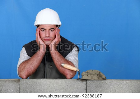 A frustrated bricklayer - stock photo
