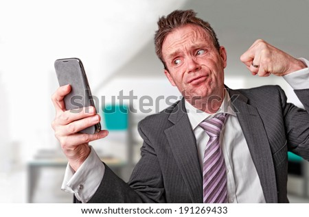 A frustrated businessman on a telephone call. Instagram Style Filter Applied. - stock photo