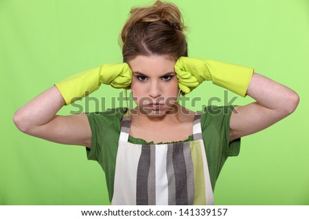 A frustrated housewife - stock photo