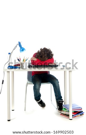 a frustrated student, trying to do his homework. On a white background. - stock photo