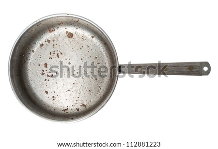 A frying pan with lots of grease and crumbs of ground beef, isolated on a pure white background. - stock photo