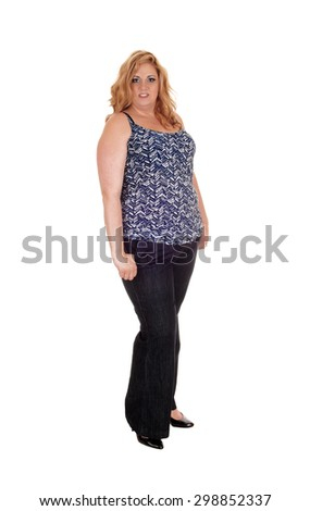 A full body picture of a plus size woman standing isolated for white background in jeans and high heels.  - stock photo