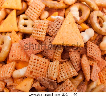 A full bowl of party mix.  This salty treat is ready for snacking. - stock photo