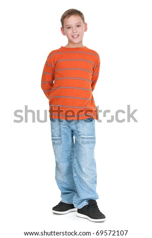 A full height portrait of a boy dressed in casual; isolated on the white background - stock photo