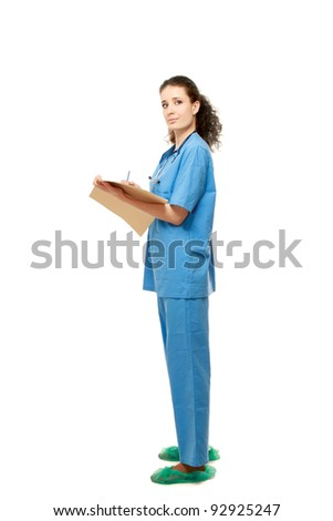 A full-length portrait of a female doctor with folder, isolated on white background - stock photo
