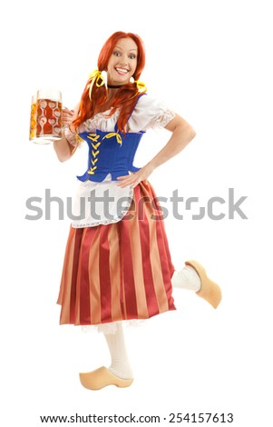 A Full Length Portrait of a Happy Woman Wearing a Traditional Octoberfest Costume Holding Two Beer Gasses Isolated on White Background - stock photo