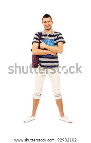 A full-length portrait of a young guy with books , isolated on white background - stock photo