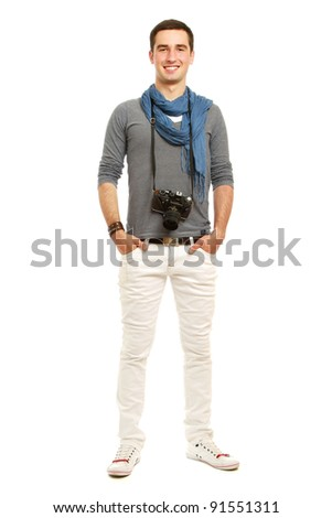 A full-length portrait of a young photographer with a camera, isolated on white background - stock photo