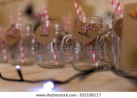 A Funky drinking glass with stripey straws - stock photo