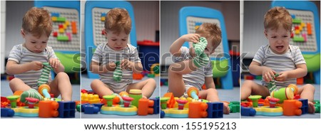 A funny baby boy trying to dress socks in children's room - stock photo