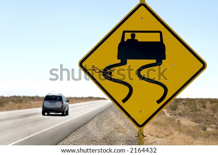 A funny but sick sign along a desert highway. - stock photo
