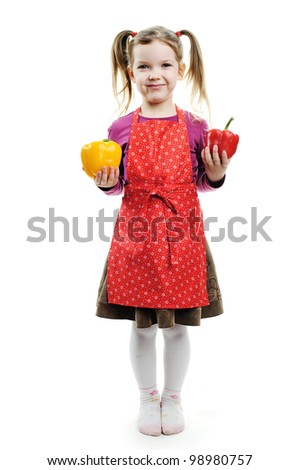 A funny girl with red and yellow paprika - stock photo