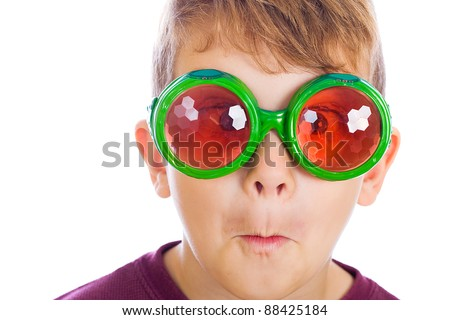 A funny kid wearing bug eyed glasses. - stock photo
