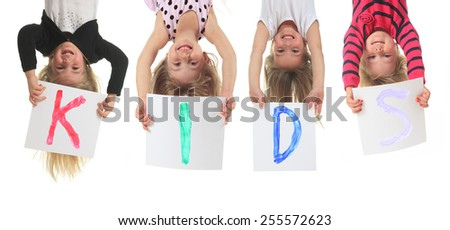 A funny upside down kid with smile - stock photo