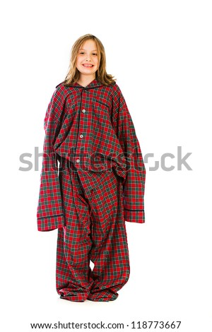A funny young girl wearing giant oversized pajamas. - stock photo