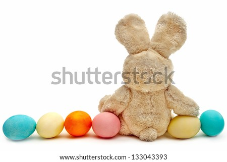 A fur rabbit and colorful eggs - stock photo