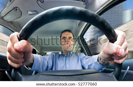 A furious man driving, as seen from behind the wheel. Shot using a very wide fisheye lens. - stock photo