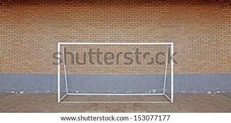 A futsal soccer goal post against a brickwall.  - stock photo