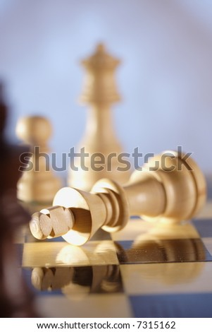 A game of chess comes to an end. The king is checkmated. - stock photo