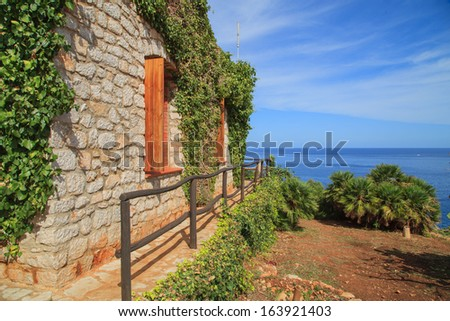 A garden of Sicilian house near the seaside in Zingaro National Park - stock photo