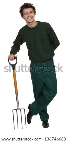 A gardener standing relaxed, holding a fork, isolated on white - stock photo