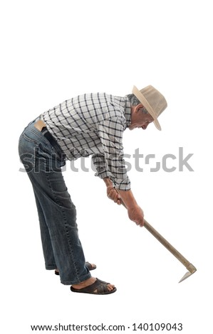a gardener works with a hoe - stock photo