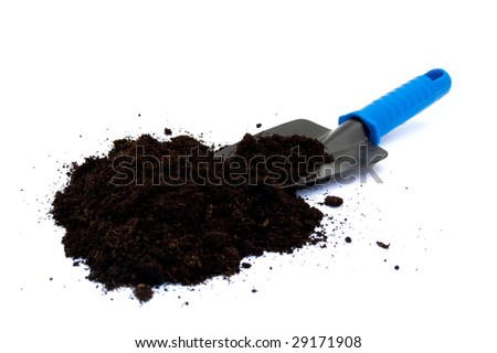 A gardening spade with potting compost on white - stock photo