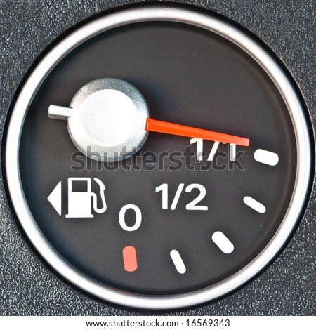 A gas gauge showing full tank level - stock photo