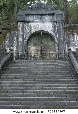 A gate in the Buu Thanh, a wall round theTomb of Minh Mang. It is only opened on the anniversary of the Emperor's death.  Built in 1841.  The body is in an underground sealed palace the Huyen Cung. - stock photo