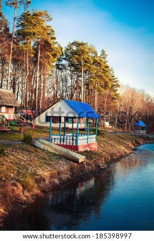 A gazebo located on the shore of a small lake - stock photo