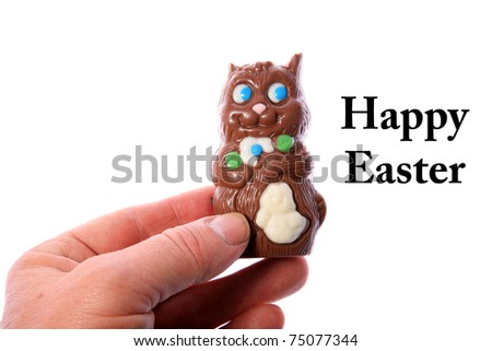 a generic chocolate easter bunny with his ears bitten off - stock photo