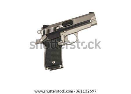 A generic compact 9mm semi-automatic handgun suitable for a police officer's off duty weapon or a civilian concealed carry weapon. - stock photo