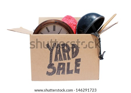A Genuine Box of used items ready for a garage sale, Yard Sale, Auction, or donation to a charitable organization. One man's junk is another man's treasure! Isolated on white with room for your text  - stock photo