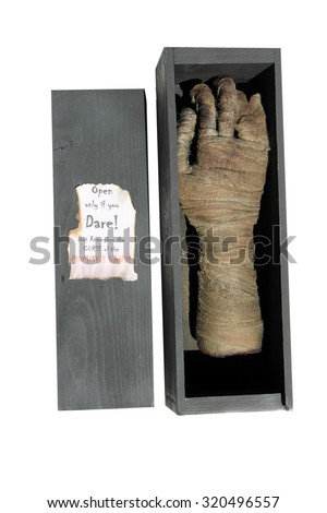 A Genuine Egyptian Cursed Mummy's Hand in an antique wooden shipping box. Isolated on white with room for your text. Egyptian Mummy's are known around the world to be Cursed and come to life to attack - stock photo