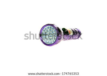 A Genuine Ultra Violet aka Black Light Flashlight. Isolated on white with room for your text. Ultra Violet Flashlights are used to illuminate things that fluoresce under UV Light and in Forensics ID.  - stock photo