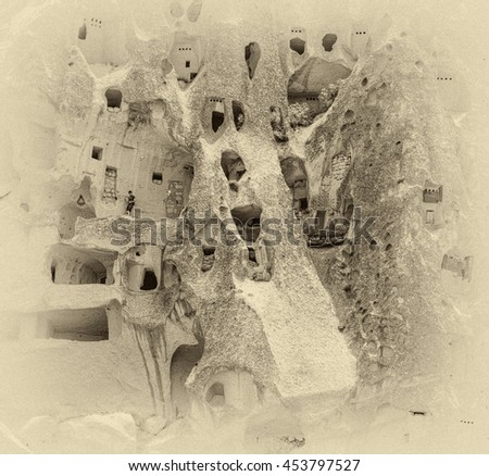 A geological formation consisting of volcanic tuff with cave dwelling. Cappadocia in Central Anatolia is a UNESCO World Heritage Site since 1985, Turkey (stylized retro) - stock photo