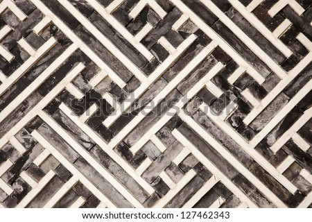 A geometric pattern made of wood slats is one of the architectural details in one of the buildings in the Gyeongbokgung Palace complex in Seoul. - stock photo