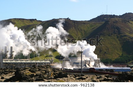 A geothermal power station steams on a cold day in Iceland - stock photo