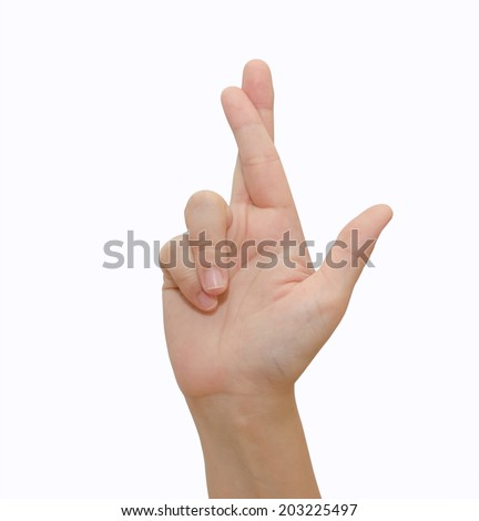 a gesturing good luck symbol fingers crossed human hand on white - stock photo