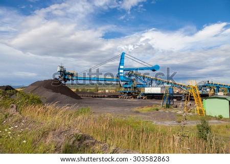 A giant wheel excavator in brown coal mine - stock photo