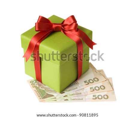 A gift and ukranian grivnas on white background - stock photo