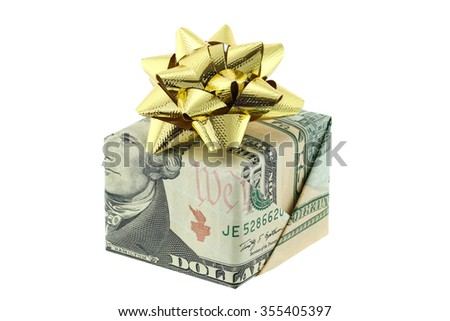 A gift box wrapped with United stated bills decorated with golden gift ribbon,  isolated on white background - stock photo