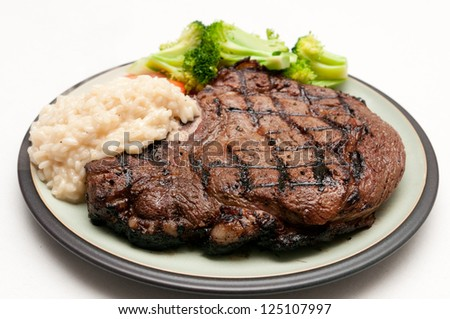 a gigantic rib steak fresh from the grill - stock photo