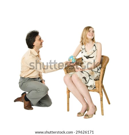 A girl and a man giving her a globe - stock photo