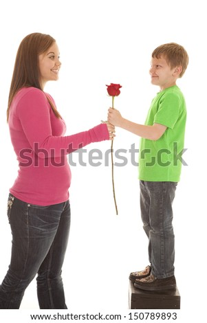 A girl and a young boy both holding onto a rose - stock photo